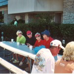 Gathering of people at picnic table
