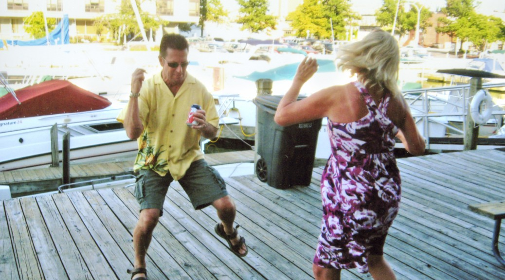 People dancing on dock