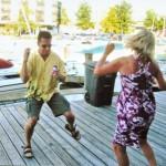 People dancing on dock