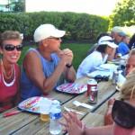 People talking at picnic table