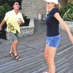 People dancing on the dock
